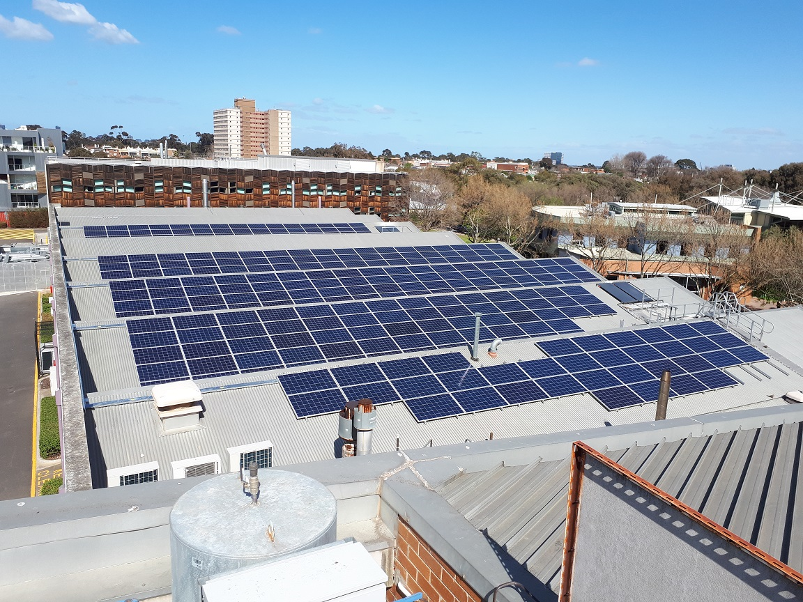 Rooftop solar panels on large university campus building