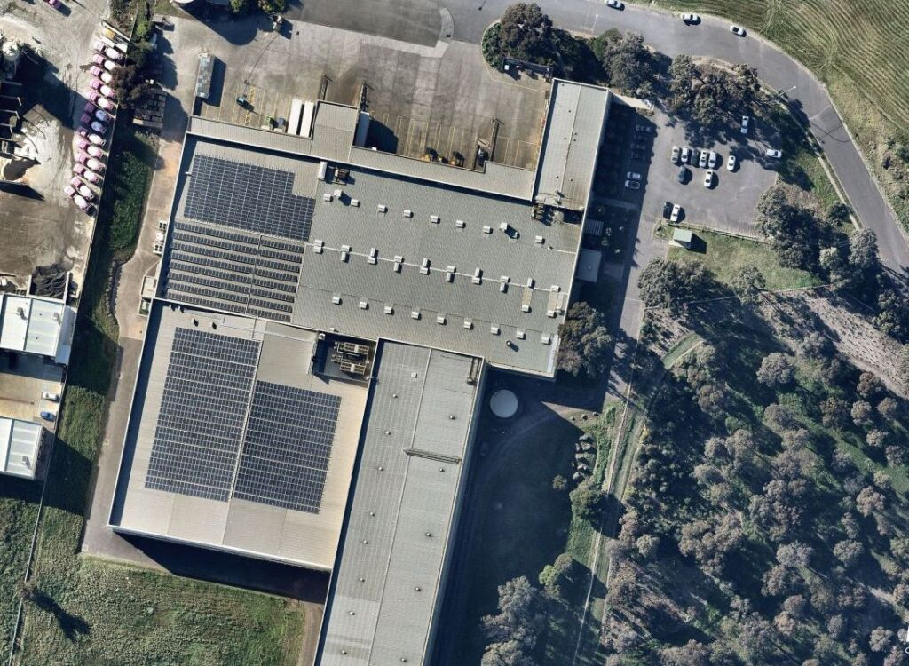Birds eye view of the rooftop of Conga Foods building showing extensive solar panels covering the roof