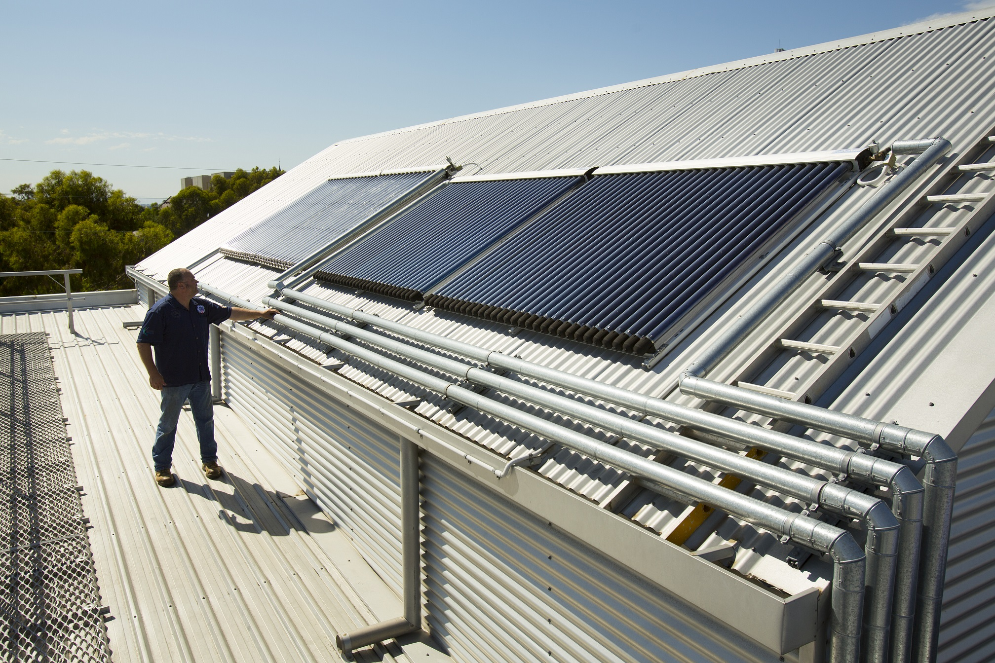 Solar panels on top of an industrial roof