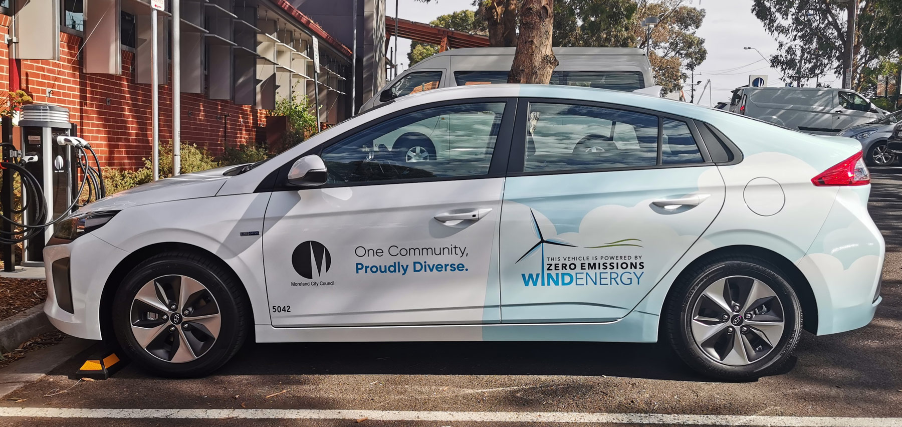 Electric car with Moreland Council logo and Crowlands Wind Farm decal