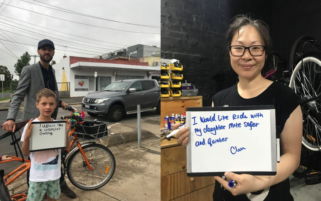 Moreland Bicycle User members holding a small whiteboard where they have written that they would like safer biking streets